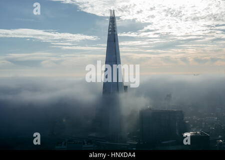 The city and Shard, the highest building in London, UK, consumed by fog. - Stock Photo
