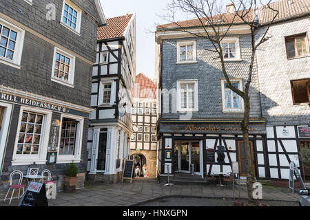 HATTINGEN, GERMANY - FEBRUARY 15, 2017: Many of the historic houses have retail shops in their ground floor and - Stock Photo