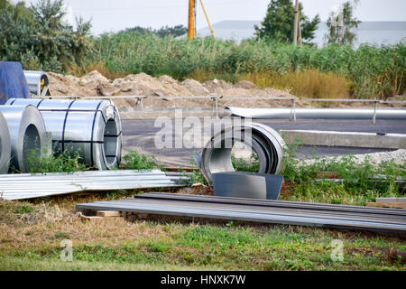 Rolls of sheet metal. Storage of building materials. - Stock Photo