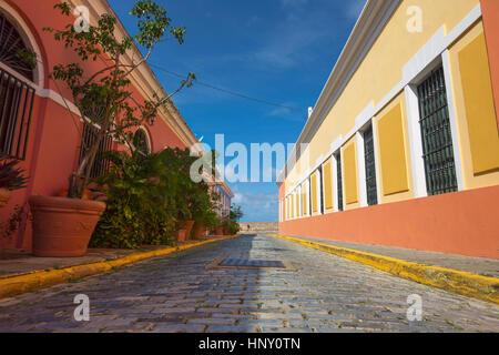 COBBLESTONE STREET COLORFUL PAINTED BUILDINGS CALLE VIRTUD OLD TOWN SAN JUAN PUERTO RICO - Stock Photo