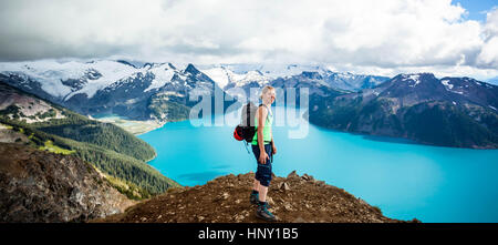 Standing at the Summit of Panorama Ridge in Garibaldi Provincial Park - Stock Photo