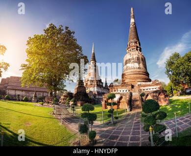 Stupa temples in Wat Yai Chai Mongkol monastery in Ayuttaya, Thailand - Stock Photo