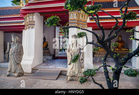 Stone statues in Buddhist Temple Wat Pho in Bangkok, Thailand - Stock Photo