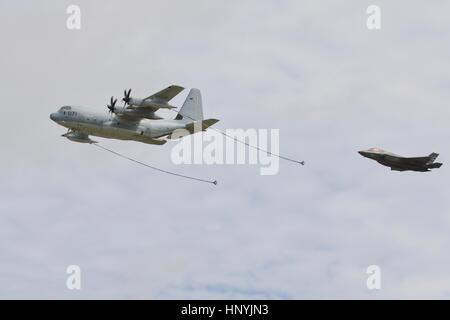 US Marines KC-130J Hercules simulating the refuelling of a F-35B Linghtning ll at the Royal International Air Tattoo - Stock Photo