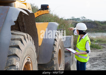 Woman engineer on a construction site, Selective focus and small depth of field - Stock Photo