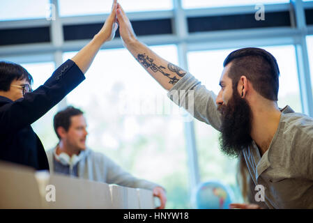 Colleagues congratulating each other - Stock Photo