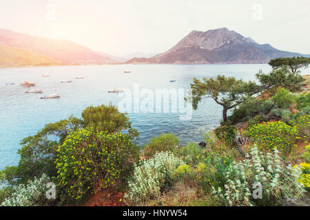 The picturesque sunset. View of the boats at sea. Turkey - Stock Photo