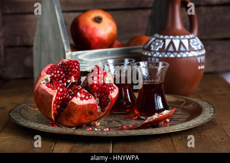 Ripe pomegranate fruit on wooden vintage table. Close view - Stock Photo