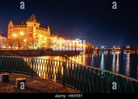 The magnificent Prague Castle at night along the River Vltava. - Stock Photo