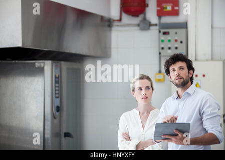 Colleagues working on project with digital tablet - Stock Photo