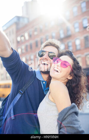 Couple posing for a selfie - Stock Photo