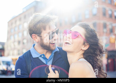 Couple laughing together outdoors - Stock Photo