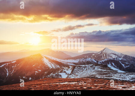 Colorful spring sunset over the mountain ranges in the national  - Stock Photo