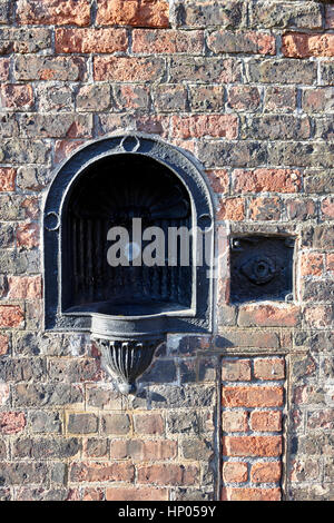 old cast iron water fountain in the walls of liverpool docks dockland uk - Stock Photo