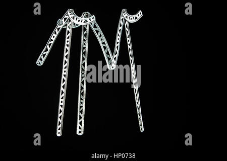 Abstract concept image of friends walking and talking, made with vintage erector set toy parts, photographed on - Stock Photo