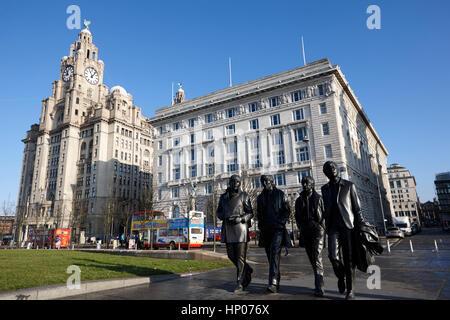 the beatles statue and pier head landmark buildings liverpool uk - Stock Photo