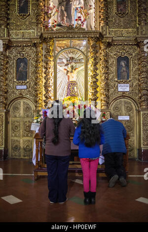 Prayers inside of San Francisco Church, founded in 1548 and rebuilt 1784, La Paz, Bolivia - Stock Photo