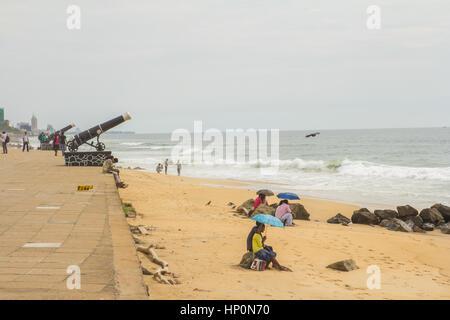 Colombo, SRI LANKA - NOVEMBER 25: young couples sit on the beach Galle Face Green  in Colombo, Sri Lanka on 25 November - Stock Photo