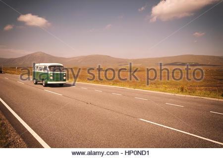 Vintage VW Volkswagen bus green road trip highway - Stock Photo