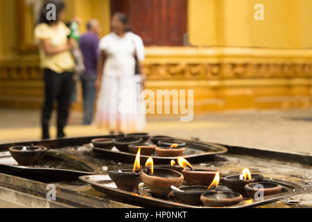 clay oil lamps in hinduist temple - Stock Photo