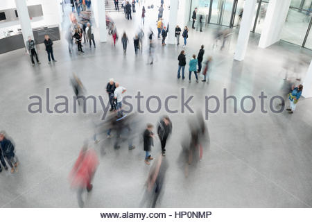 Visitors people crowd museum gallery blur art hall - Stock Photo