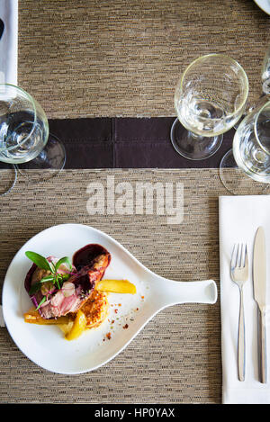 Entree on restaurant table - Stock Photo