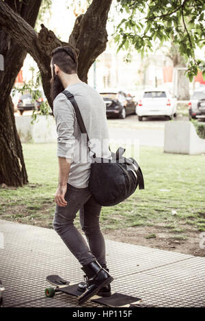 Man longboarding on sidewalk - Stock Photo