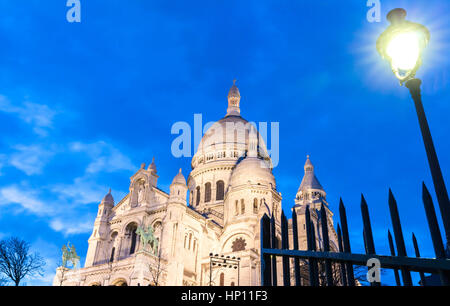 The Sacre Coeur basilica in the evening, Paris. - Stock Photo