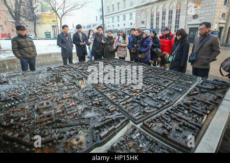 ZAGREB, CROATIA - JANUARY 15, 2017 : Tourists sightseeing the scale model of Zagreb city exhibited at the European - Stock Photo
