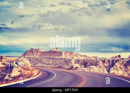 Vintage toned scenic road in Badlands National Park, South Dakota, USA. - Stock Photo