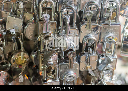 KATHMANDU, NEPAL - 06 December 2016: Shiny silver locks on display at a street market, 6 December 2016 in Kathmandu, - Stock Photo