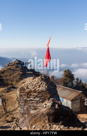 Hindu holy site on the path to Pathibhara Devi Temple with view over the Himalayan foothills, Taplejung, Nepal - Stock Photo