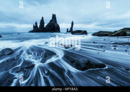 The Rock Troll Toes. Reynisdrangar cliffs. Black sand beach - Stock Photo