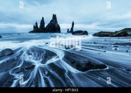 The Rock Troll Toes. Reynisdrangar cliffs. Black sand beach - Stock Photo