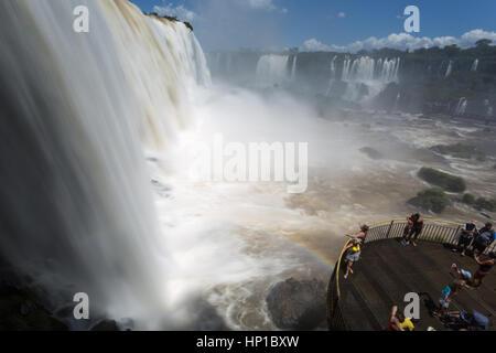 Foz do Iguaçu, Brazil. 16th February, 2017. View of visitors on walkway near waterfalls during sunny day in Iguaçu - Stock Photo