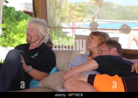Neckar Island, Caribbean, British Virgin Islands. 17th Nov, 2014. Sam Branson snuggles with his wife Bellie next - Stock Photo