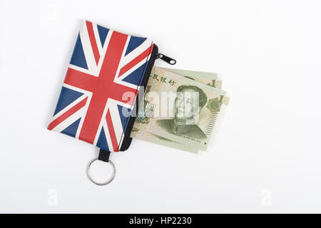 Union Jack coin purse with Chinese 1 Yuan banknotes - as metaphor for Yuan / Renminbi-Sterling exchange rate. - Stock Photo