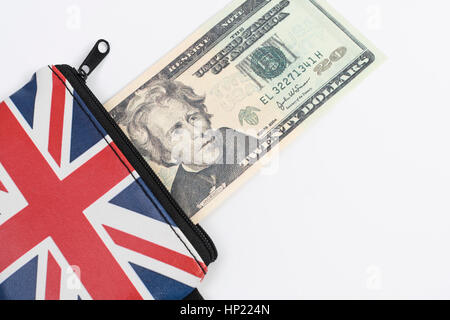 Union Jack coin purse with US 20$ / twenty dollar bill / banknote - as metaphor for US Dollar-Sterling exchange - Stock Photo