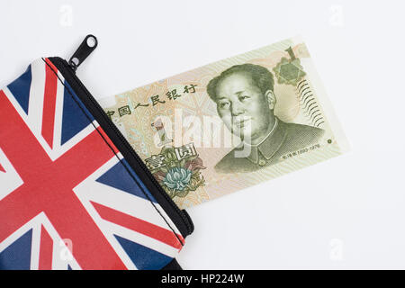 Union Jack coin purse with Chinese 1 Yuan banknote - as metaphor for Yuan / Renminbi-Sterling exchange rate. - Stock Photo