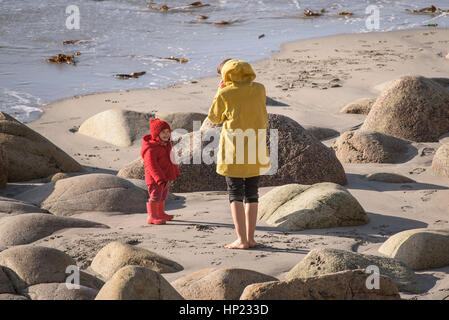 A mother and daughter playing on Porth Nanven beach Cornwall England UK - Stock Photo