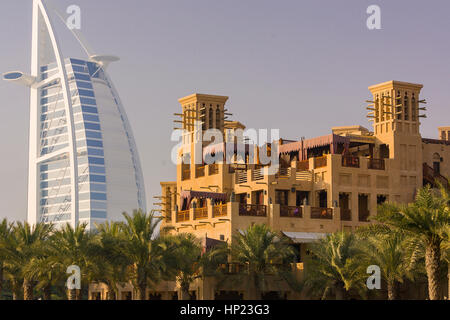 DUBAI, UNITED ARAB EMIRATES - The Burj Al Arab luxury hotel, left, in Jumeirah. - Stock Photo