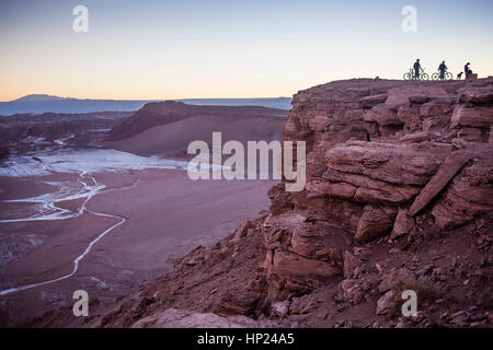 Tourist in Piedra del Coyote (Coyote Rock). Panorama on Valle de la Luna (Valley of the Moon ), and salt deposited - Stock Photo