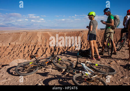 Biking, bicycle, Cyclists in cornice, Valle de la Muerte (Valley of the Death), Atacama desert. Region de Antofagasta. - Stock Photo