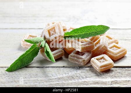 sage candies on wooden background - Stock Photo
