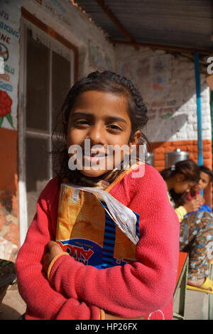 Indian girl with school book - Stock Photo