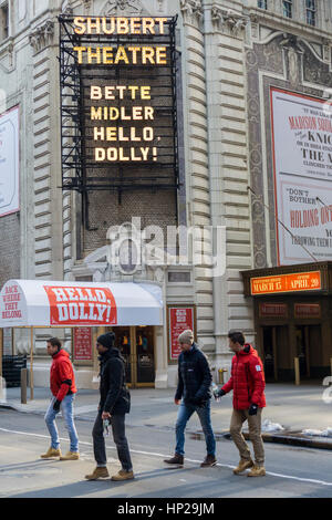 The marquee of the Shubert Theatre off of Broadway in New York displays the upcoming 'Hello Dolly!' musical starring - Stock Photo