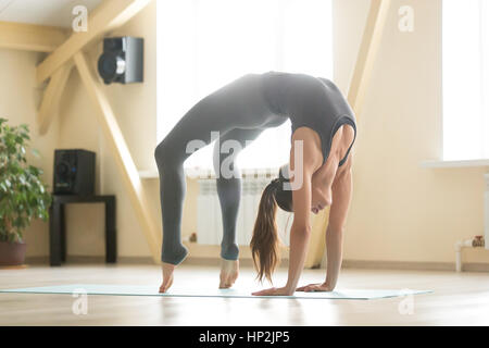lady in yoga pose dhanurasana mr773b stock photo