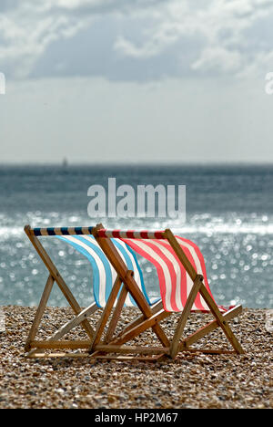 Two Empty Deck Chairs on a Beach