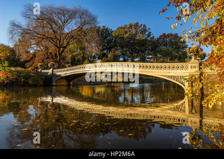 Fall in Central Park at The Lake with the Bow Bridge. Manhattan, New York City - Stock Photo