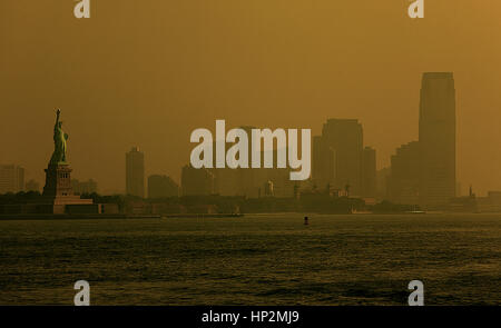 Statue of Liberty and skyline of New Jersey,  New York City, USA - Stock Photo